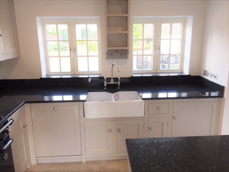 Fully bespoke, hand built from solid wood,shaker style kitchen painted in Farrow & Ball Elephants Breath