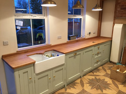 Fully bespoke solid wood shaker style fitted kitchen.Individually tailored island site with solid black walnut top.